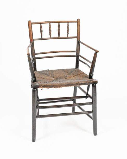 A Morris & Co Sussex ebonised wood armchair, turned legs with bobbin back, with …