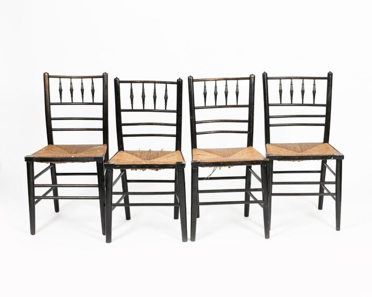 A set of four Morris and Co Sussex ebonised wood chairs, each turned wood frame …