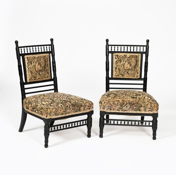A pair of Aesthetic Movement ebonised wood bedside chairs, with turned bobbin ba…