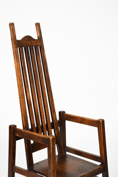 An oak armchair in the manner of Charles Frances Annesley Voysey, square plank s…