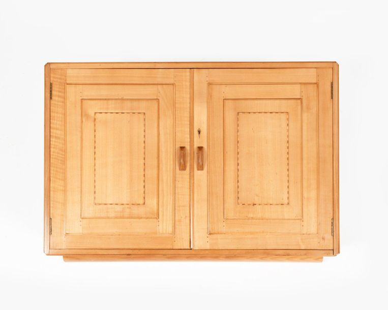 A Gordon Russell cherry wood hanging wall cabinet, twin, hinged panel doors with…