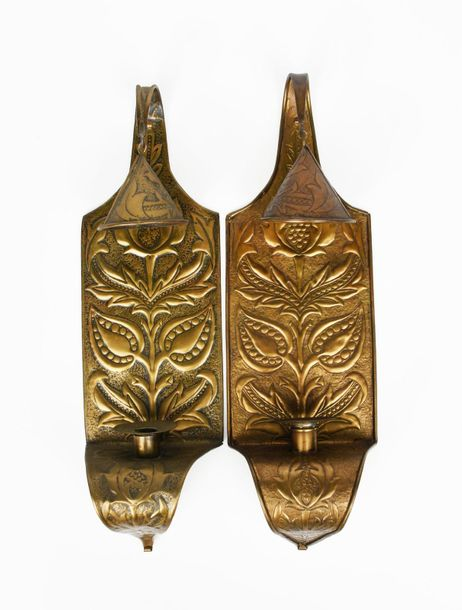 A pair of patinated brass wall sconces, each rectangular with curved tapering fi…