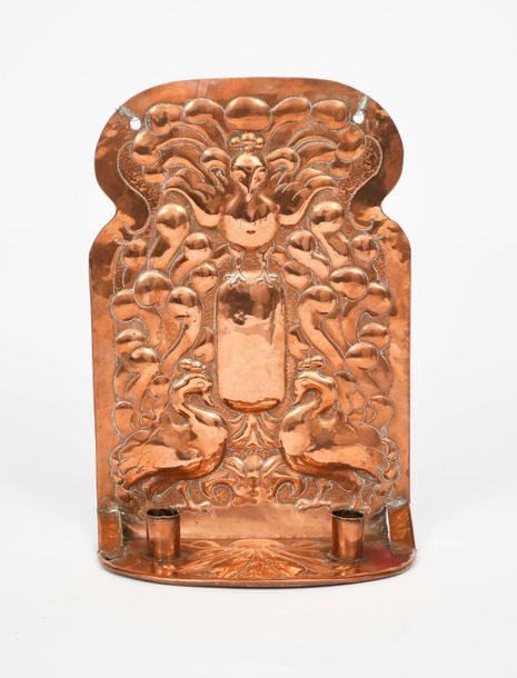 A twin light copper wall sconce, shaped rectangular back plate stamped in low re…
