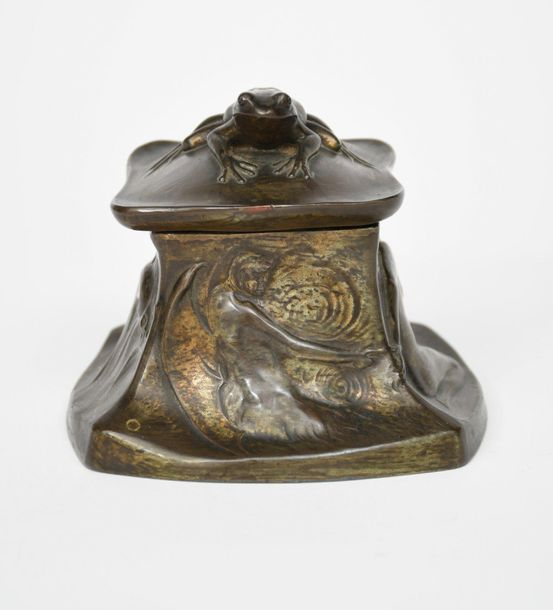 An Art Nouveau patinated bronze inkwell, tapering square section, cast in low re…