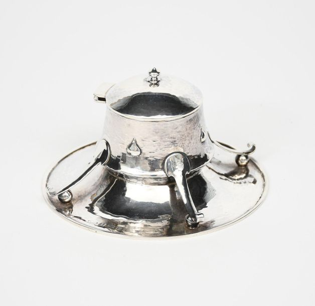 An Arts and Crafts A E Jones silver inkwell, circular flaring base supporting ta…