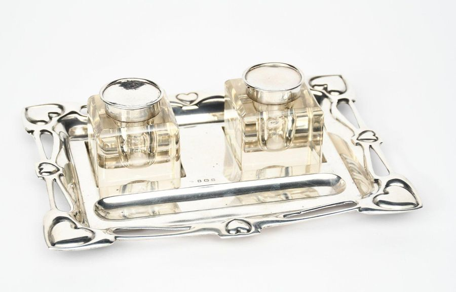 A William Aitken silver double inkwell and pen tray with two glass inkwells, the…