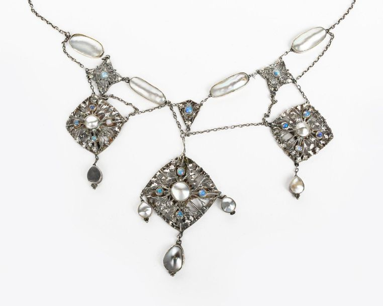 A silver and opal necklace designed by Kate Eadie, the main silver pendant cast …