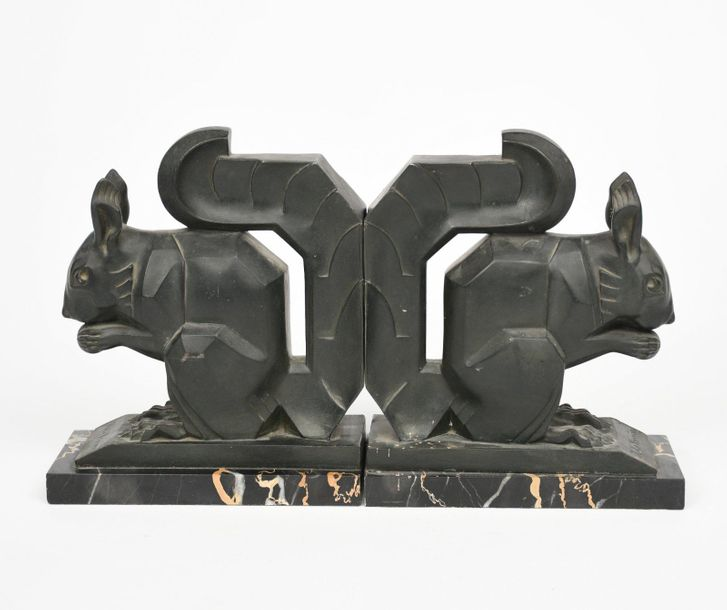 Max Le Verrier A pair of large patinated metal squirrel bookends, each modelled …