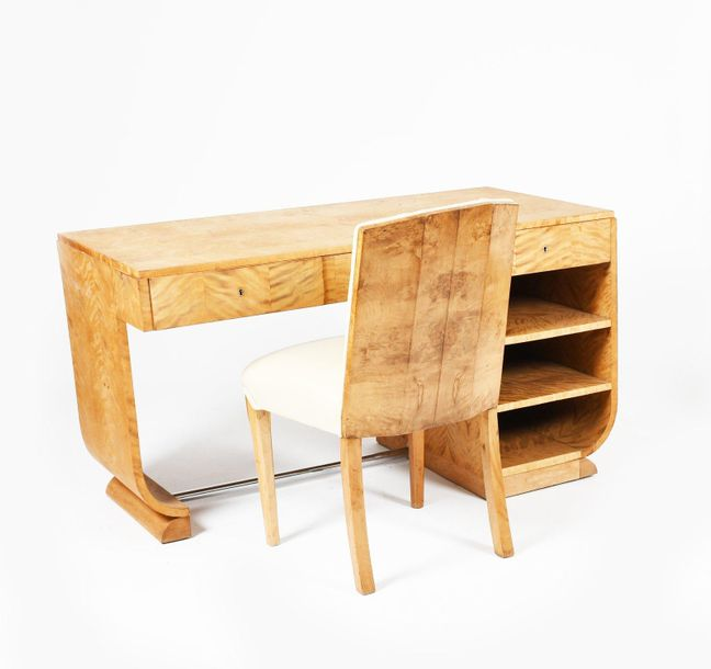 A Modernist satinwood desk and matched chair, rectangular top over three drawers…