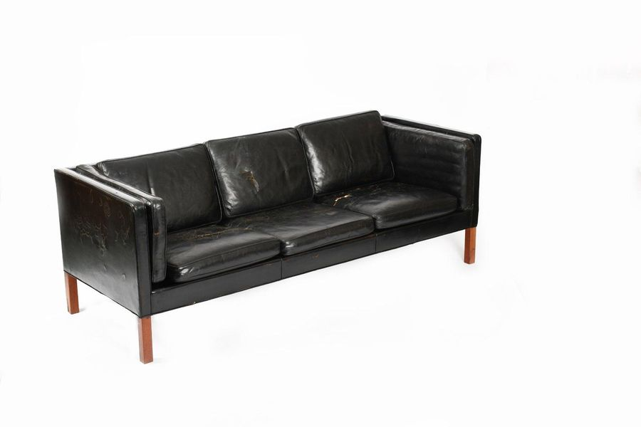 A Danish black leather three seat sofa in the manner of Borge Mogensen, black le…