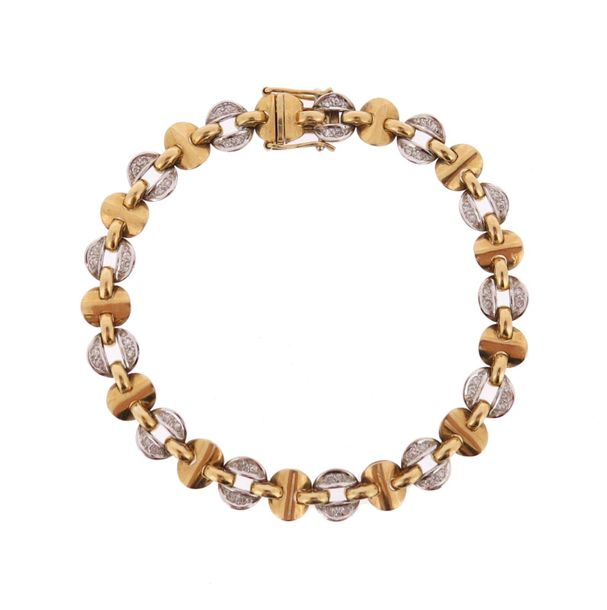 A diamond set two colour gold bracelet, alternately set with gold disc links and…