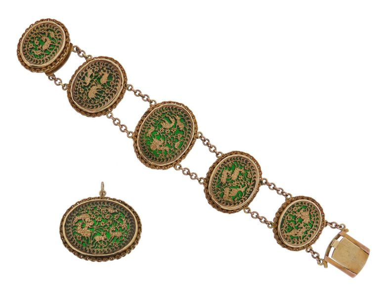 An Indian gold Pertabghar bracelet and brooch, the oval links with green enamel …