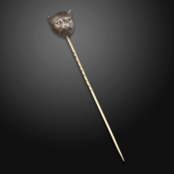An early 20th century diamond set tie pin, designed as a cat's head with rose cu…