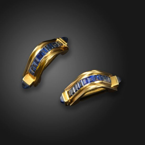 A pair of sapphire set gold cufflinks, of stirrup form and set with calibre cut …