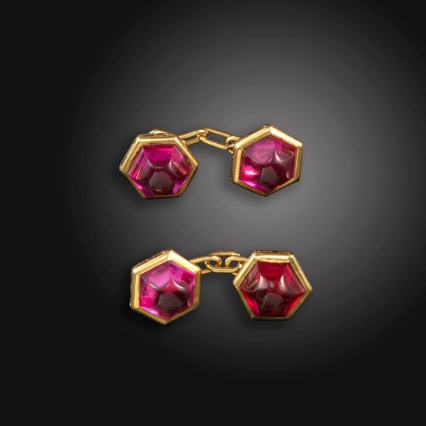 A pair of synthetic ruby set gold cufflinks, the hexagonal gold cabochons set in…