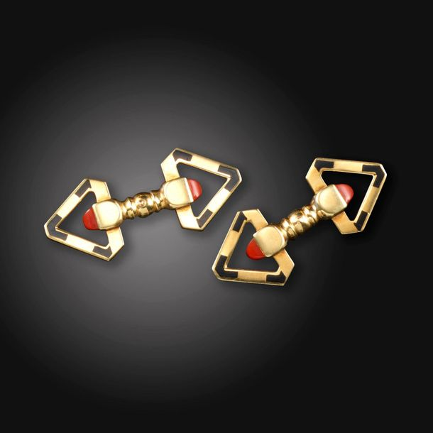 A pair of coral and black enamel triangular gold cufflinks, c.1940, set with sug…