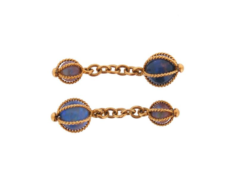 A pair of opal bead mounted gold cufflinks, each opal bead contained in an 18ct …