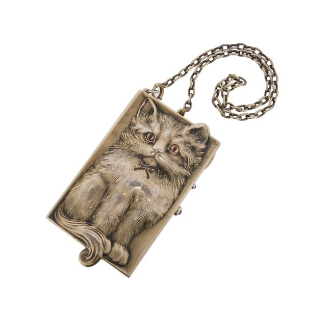 An early 20th century cat form silver gilt minaudière, the rectangular box reali…