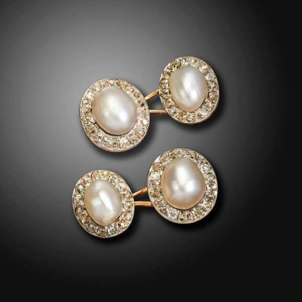 A pair of French pearl and diamond cluster cufflinks, each pearl is set within a…