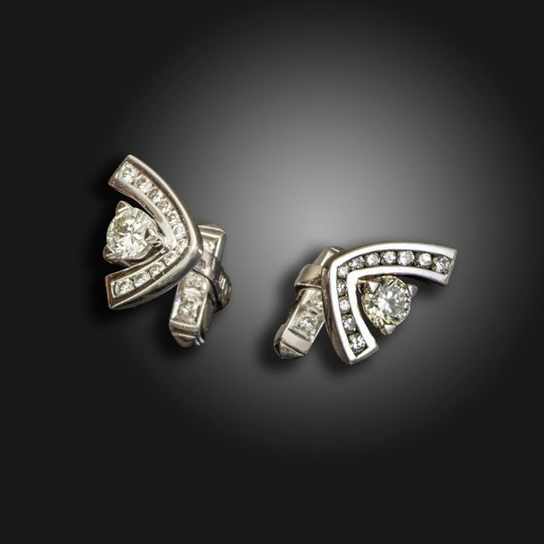 A pair of diamond set abstract cufflinks by Larry, each set with a round brillia…