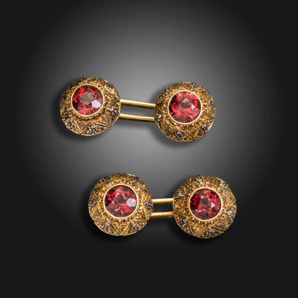 A pair of garnet set yellow and white gold cufflinks, c.1900, each dome shaped l…