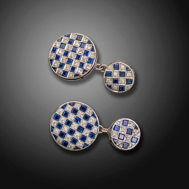 A pair of sapphire and diamond chequerboard circular cufflinks, alternately set …