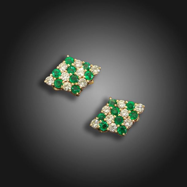 A pair of emerald and diamond set cufflinks by Larry, each lozenge shaped link s…