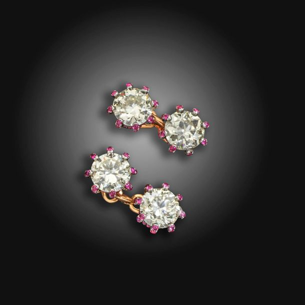 A pair of diamond and ruby set cufflinks, the four transitional circular cut dia…