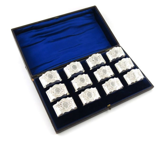 A set of twelve Edwardian silver napkin rings, by Jackson and Fullerton, London …