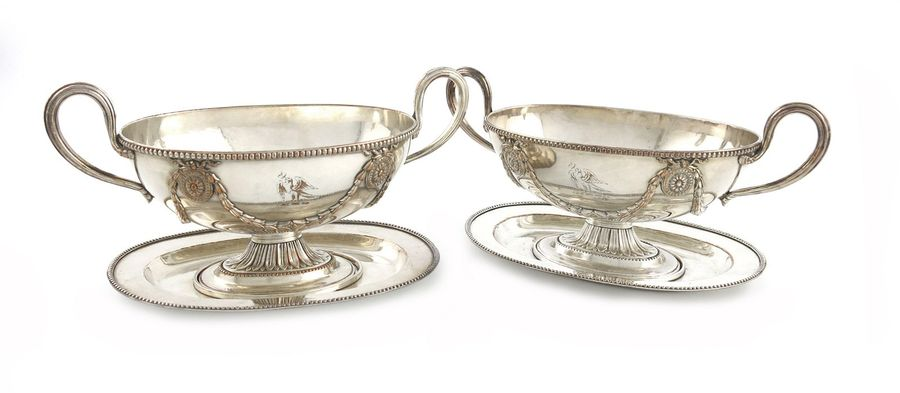 A pair of George III old Sheffield plated sauce tureens and stands, unmarked, pr…