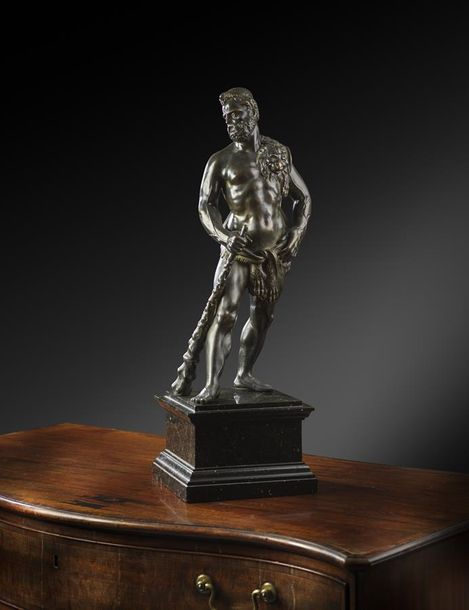 An Italian bronze figure of Hercules, the divine hero standing holding his club,…