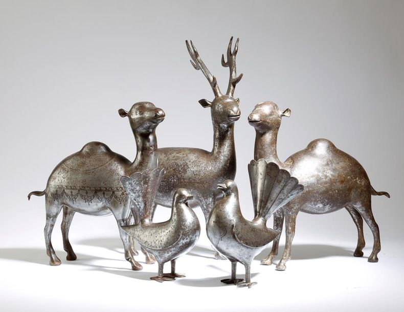 Five Qajar damascened steel animals, comprising: a pair of peacocks, a stag and …