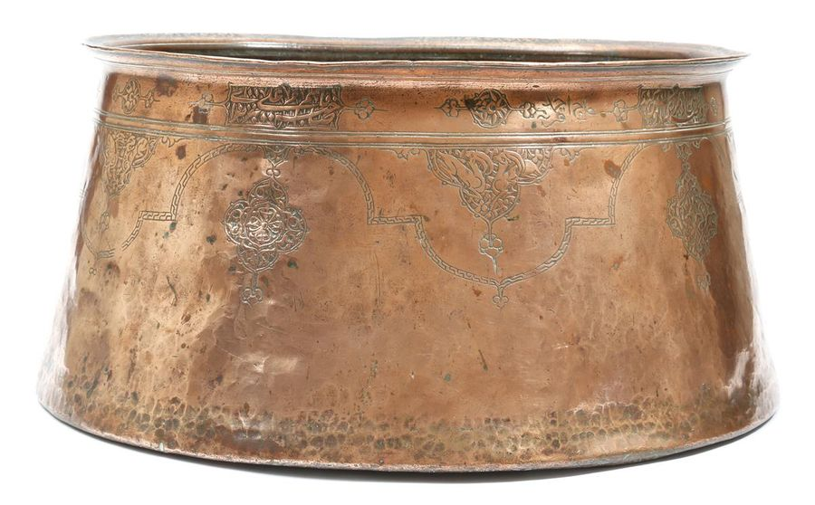 A Safavid copper basin, of tapering form, decorated with panels of animals, scro…