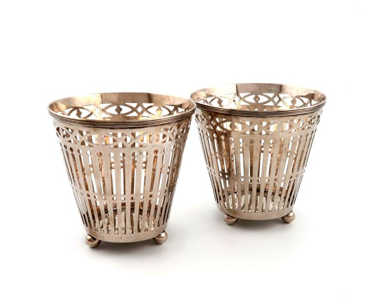 A pair of Dutch silver vases, 1911, tapering circular form, pierced with vertica…