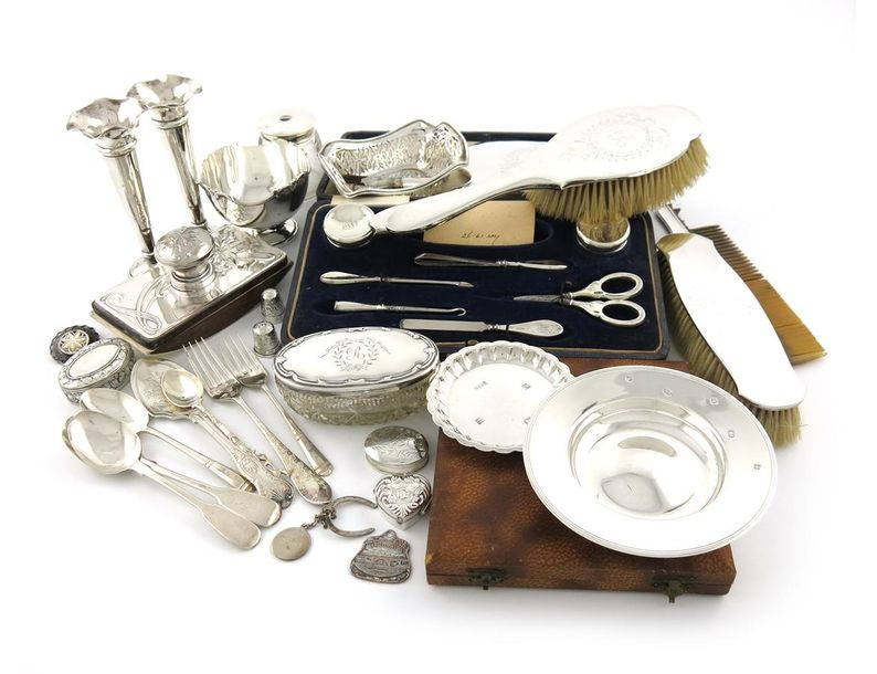 A mixed lot of silver items, various dates and makers, comprising: a pair of vas…