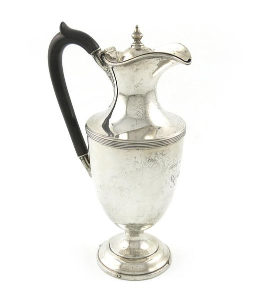 An Edwardian silver hot water pot, by H. Woodward and Co, London 1906, vase form…