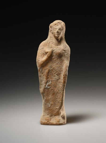 A Statuette of a Kore Greek early 5th cent. B.C..  Terracotta. H. 13.6 cm. W. 4.…