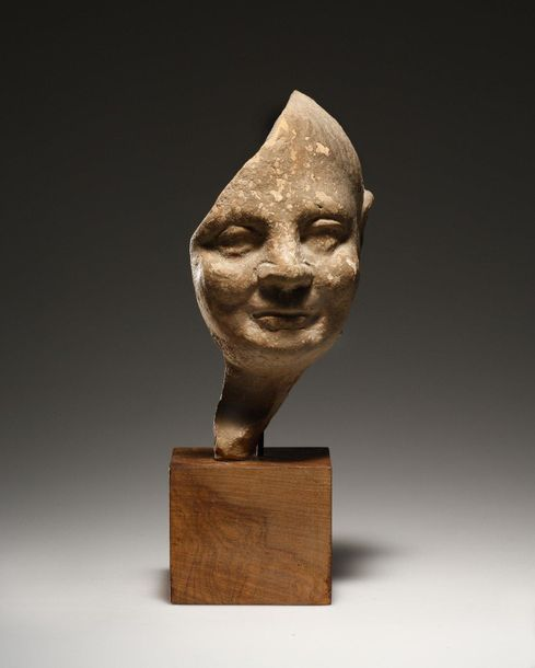 A Fragment of a Child's Head Etruscan 3rd 2nd cent. B.C..  Terracotta. H. 16.6 c…