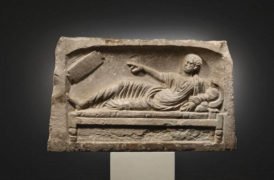 A Funeral Relief with a Reclining Man Roman Provinces 2nd cent. A.D..  Limestone…