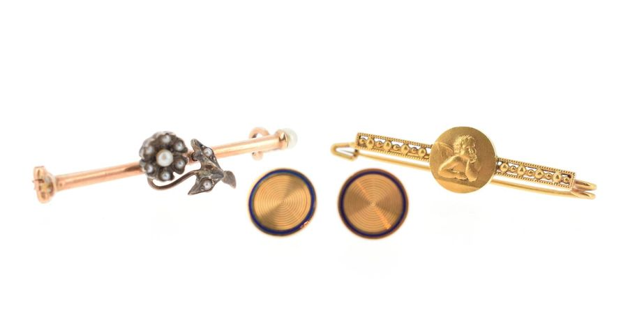 Lot de bijoux en or jaune 18 K (750 °/°°) comprenant : une broche barrette angel…