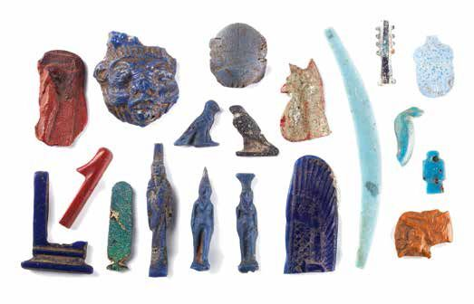ENSEMBLE D'AMULETTES A GROUP OF EGYPTIAN FAIENCE AMULETS AND GLASS INLAYS Comprenant…