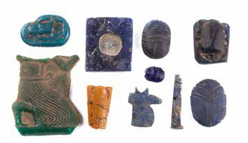ENSEMBLE D'AMULETTES ET D'INCRUSTATIONS A GROUP OF EGYPTIAN GLASS AMULETS AND INLAYS…