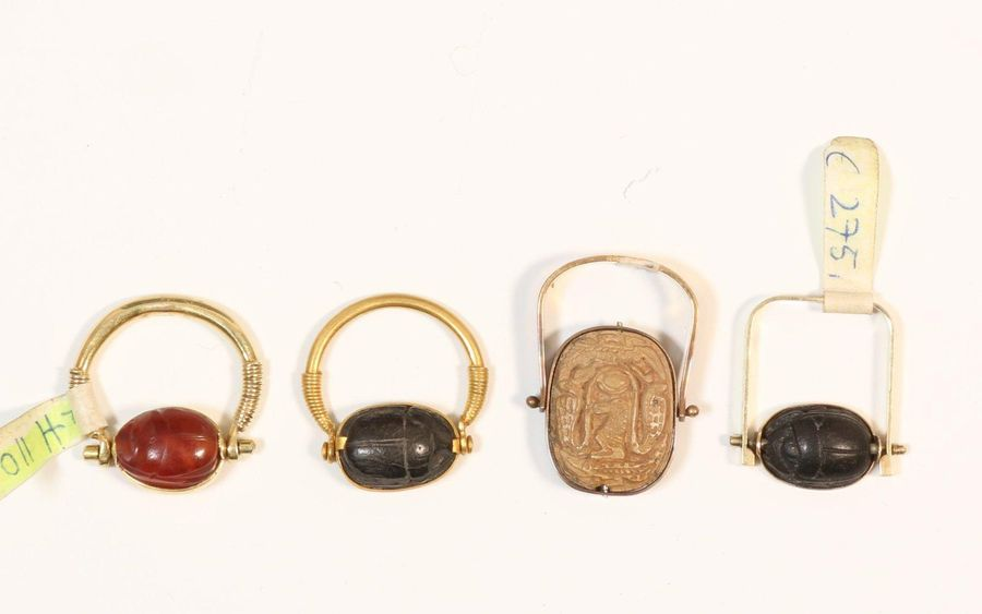 Egypt, collection of rings, Late Period, unmarked 14K gold, sapphire, scarab and…