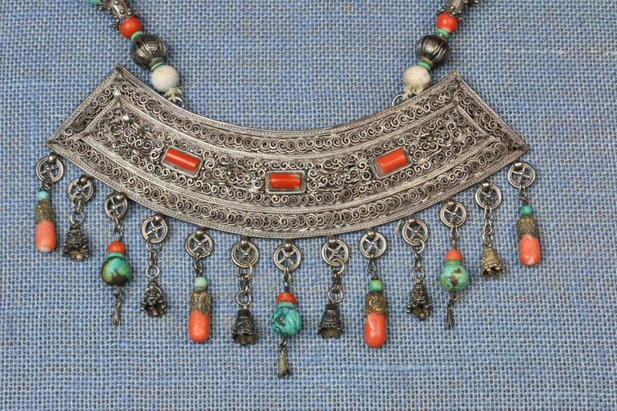 Mongolia, necklace with broad pendant, with filigree wave patterns, inlaid coral…