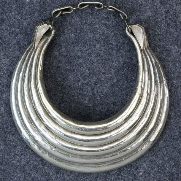 Golden Triangle, Hmong, five layer silver neckring, with three engraved links in…