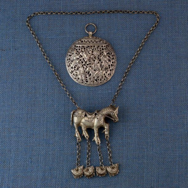 China, Miao, horse amulet chain necklace and amulet with four figures and a hors…