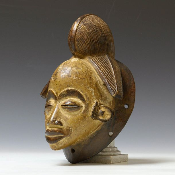 Gabon, Punu, face mask, ca. 1950, with fine carved hair and brown, black and whi…