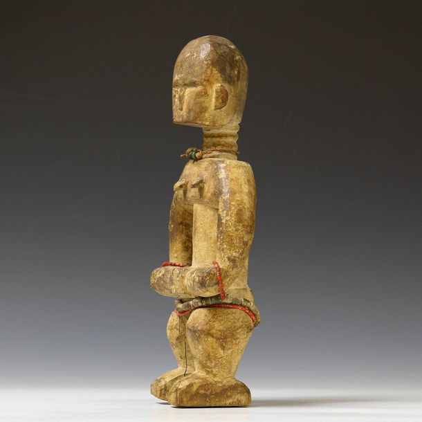 Ghana, Akan, standing female figure, with hands joined, beaded necklaces and whi…