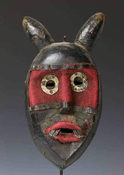 Ivory Coast, Dan, face mask, with two bulbous horns and red cotton cloth and alu…