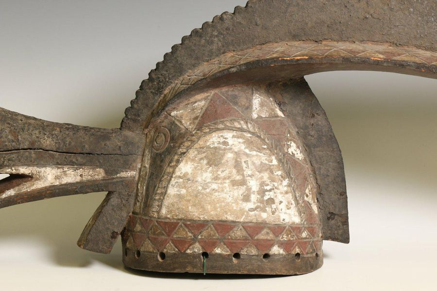 Burkina Faso, Mossi, animal crest mask, with extented beak, curved hair comb, en…
